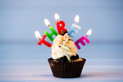 Cupcake with a candles for 3 - third birthday Stock Photography