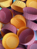 Cupcake cases. Colored cupcake cases orange and purple Royalty Free Stock Images