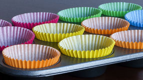 Cupcake cases. In baking tray Royalty Free Stock Photography