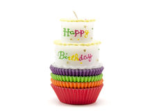 Cupcake cases with a cake Royalty Free Stock Images