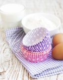 Cupcake cases and ingredients Royalty Free Stock Photography