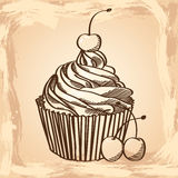 Cupcake with cherries on a beige background. Stock Photos