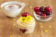 Cupcake with Cherries and Coffee. Jam Cupcake with Mascarpone cream and cherry shot in studio on a table Stock Photos