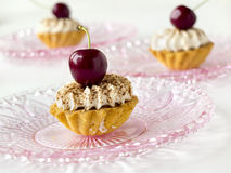 Cupcake with cherries and whipped cream Royalty Free Stock Photo