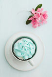 Cupcake and cherry blossoms. Pink buttercream cupcake and cherry blossoms stock photos