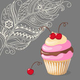 Cupcake with cherry on the boho background Stock Photo