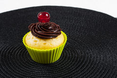 Cupcake with cherry. Cupcake in silicone baking cups Royalty Free Stock Images