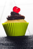 Cupcake with cherry. Cupcake in silicone baking cups Royalty Free Stock Photography