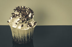 Cupcake with chocolate. On a black table with a white background of with copy space Stock Photo