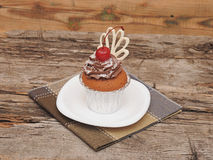 Cupcake with chocolate cream Stock Images
