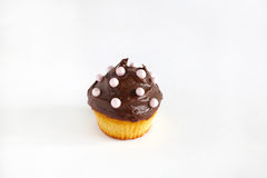 Cupcake with chocolate ganache and pink pearls, isolated Royalty Free Stock Images