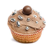 Cupcake with chocolate icing and decoration against white background Stock Images