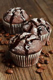 Cupcake with chocolate on wood background Stock Photo