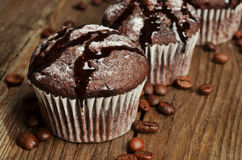 Cupcake with chocolate on wood background Royalty Free Stock Photography