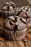 Cupcake with chocolate on wood background Royalty Free Stock Images