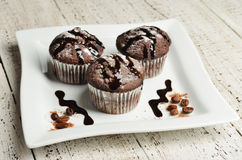 Cupcake with chocolate on wooden background Royalty Free Stock Image