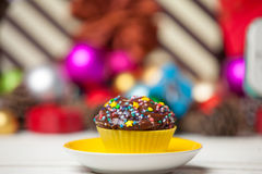 Cupcake and christmas gifts Royalty Free Stock Image