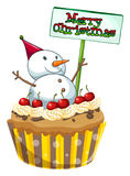 A cupcake with a christmas sign and a snowman Royalty Free Stock Image