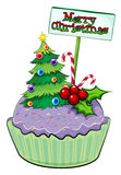A cupcake with a christmas tree and a card Royalty Free Stock Image