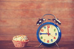 Cupcake with clock Stock Images