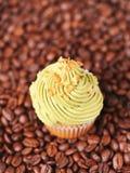Cupcake closeup. Pistachio cupcake on coffee beans, selective focus Royalty Free Stock Image