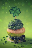 Cupcake with clover cakepick Stock Photography