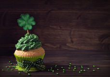 Cupcake with clover cakepick Royalty Free Stock Images