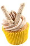 Cupcake with cocoa butter cream and  pepermint roll Stock Images