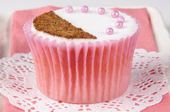 Cupcake with cocoa powder and pink pearls Royalty Free Stock Photo