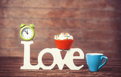 Cupcake, coffee, alarm clock Stock Photos