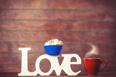 Cupcake, coffee and word Love Royalty Free Stock Photo