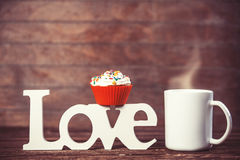 Cupcake, coffee and word Love Royalty Free Stock Image