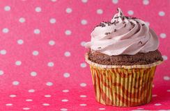 Cupcake on colored pink backround Stock Photo