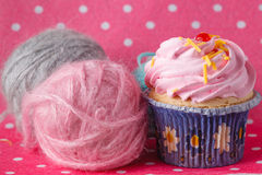 Cupcake on colored pink backround Royalty Free Stock Photography
