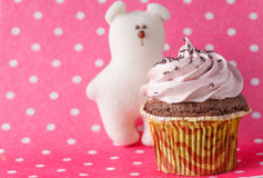 Cupcake on colored pink backround Stock Photos