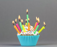 Cupcake with colorful candles royalty free stock photo
