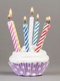 Cupcake with colorful candles Royalty Free Stock Photos