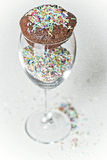 Cupcake with colorful sprinkles Stock Photos