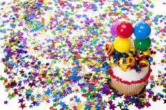 Cupcake, Confetti, Horn, and Hat at Party Royalty Free Stock Photography