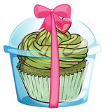 A cupcake container with a cupcake and a pink ribbon Royalty Free Stock Photography