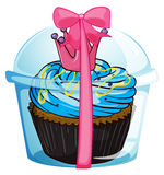 A cupcake container with a pink ribbon Stock Image