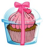 A cupcake container with a pink ribbon Royalty Free Stock Photos