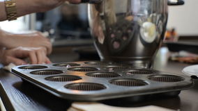 Cupcake cooking with fresh berries. Two young women are preparing cupcake stock video footage