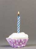 Cupcake with cream and candle Royalty Free Stock Photo