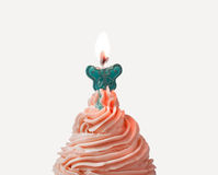 Cupcake cream and candlelight Stock Images