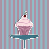 Cupcake with cream and cherry Stock Photography