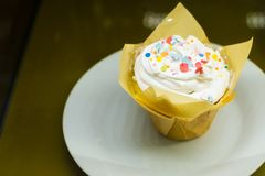 Cupcake with cream, glaze. And decoration stock images