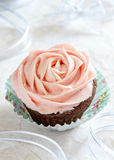 Cupcake with cream rose in light background Royalty Free Stock Photos