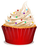 Cupcake with cream and sprinkles Stock Images