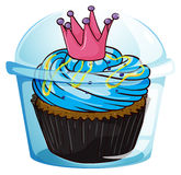 A cupcake with a crown inside the sealed container Stock Photos